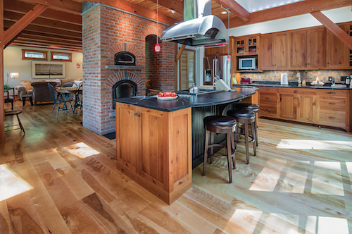 """""""Hilltop House,"""" a panelized home in Hillsborough, N.H., features a masonry heater. Credit: Great Island Photography"""